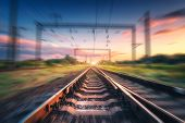 Railroad And Sky With Clouds At Sunset With Motion Blur Effect poster