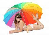 Постер, плакат: Молодая женщина в купальнике отдыхает под пляжным зонтом