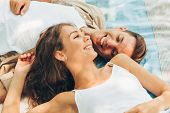 Top View Of Beautiful Couple In Love Dating Outdoors At The Park On A Sunny Day. Couple Lying On The poster