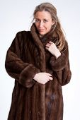 Young woman wearing a mink coat