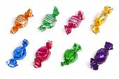 assortment of wrapped candy on white background