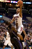 LOS ANGELES - MARCH 12: Arizona Wildcats G Lamont Jones #12 & Washington Huskies forward Darnell Gan