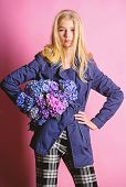 Woman Blonde Hair Posing Coat With Flowers Bouquet. Clothes And Accessory. Girl Fashion Model Wear C poster