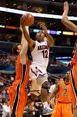 LOS ANGELES - MARCH 10: Arizona Wildcats G Lamont Jones #12 drives to the basket and lays the ball u