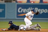LOS ANGELES - MAY 16: Milwaukee Brewers CF Carlos Gomez #27 steals second past Los Angeles Dodgers 2