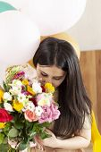 Beautiful Middle-eastern Girl With Bouquet Of Flowers. Young Attractive Female With Flowers. Portrai poster