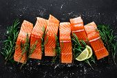 Salmon. Fresh Raw Salmon Fish Fillet With Cooking Ingredients, Herbs And Lemon On Black Background,  poster