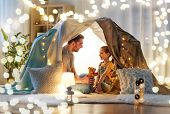 family, hygge and people concept - happy father with teddy bear toy and little daughter playing in k poster