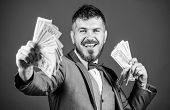Investing To Become Rich. Business Startup Loan. Bearded Man Holding Cash Money. Making Money With H poster