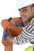 stock photo of gad  - Man using chisel and hammer - JPG