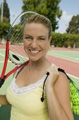 Woman with Tennis Racket and Tennis Balls