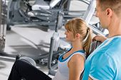 stock photo of personal trainer  - Young woman with personal trainer exercise legs at gym - JPG
