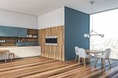 Blue And Wooden Kitchen Corner With Table poster