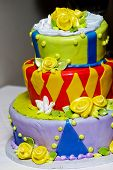 A colorful and funky wedding cake, made in a patchwork of colors