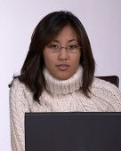 Asian Woman With Glasses At Laptop