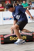 TOA PAYOH, SINGAPORE - MARCH 24 : Contenders for the under 20s in the 120kg log walk category in the Strongman Challenge 2012 on March 24, in Toa Payoh Hub, Singapore.
