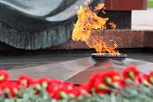 Flowers at memorial to tomb of Unknown Soldier in Alexander Garden at Victory Day; Eternal Flame