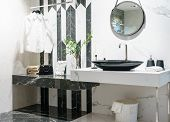 Interior Of Bathroom With Sink Basin Faucet And Mirror. Modern Design Of Bathroom poster