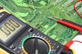 Memory Circuit Board Close Up with multimeter