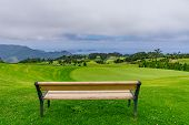 Park Bench Outdoor Landscape. Wooden Bench In Golf Course Landscape. Mountain Park Bench Panorama. P poster