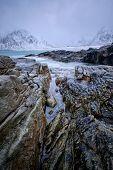 Waves and rocks on coast of Norwegian sea in fjord. Skagsanden beach, Flakstad, Lofoten islands, Nor poster