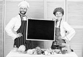 Making Good Food. Chef And Cook Helper Teaching Master Class. Couple Of Man And Woman Holding Empty  poster
