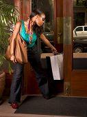 Black Woman With Shopping Bag Stuck In Door