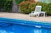 White Chair On The Poolside
