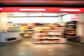 Supermarket aisle. Abstract blur