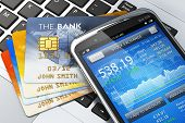 stock photo of card-making  - Mobile banking finance and making money concept - JPG
