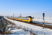 Dutch Train In Snowy Winter Landscape
