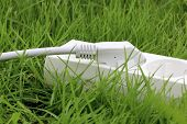 Power Strip Lying On The Grass