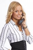 Blonde beauty speaking on the phone