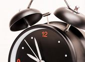black alarm clock on light background
