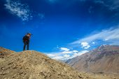 stock photo of himachal  - Photographer taking photos in Himalayas mountains - JPG