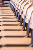 stock photo of tan lines  - Row of  empty chairs in church or office building - JPG