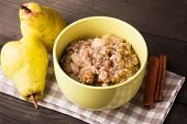 picture of walnut  - Oatmeal with pears and cinnamon and walnut on the wooden table - JPG