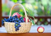 Tasty Grapes And Apples In The Basket In The Gazebo