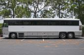 image of motor coach  - Retired tour bus with space for text on side waiting to be sold - JPG