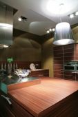 image of dutch oven  - interior to modern kitchen in brown tone - JPG