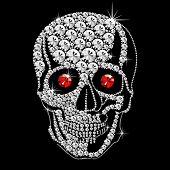 diamond skull with red ruby eyes on black background