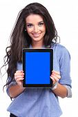 young casual woman holding a tablet with a blue screen and smiling for the camera. on white background