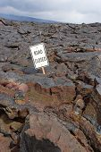 The Road Closed Sign On The Road Buried In Lava  From The Eruption Of Kilauea, Big Island Hawaii.