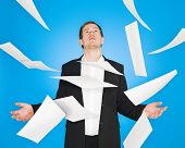 Man and flying papers on blue background