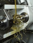 stock photo of lubricant  - Moving oil in a machine - JPG