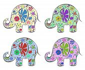 Set of elephants painted by flowers.