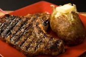 stock photo of baked potato  - grilled steak and baked potato served on square plate - JPG