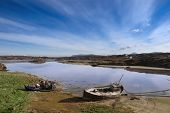 Two Beached Fishing Boats On Irish Beach