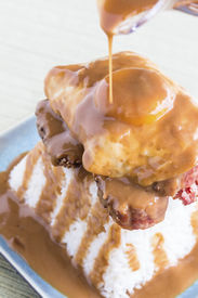 picture of loco  - Loco Moco a traditional common Hawaiian food made by stacking brisket on top of rice topped with a fried egg and covered in gravy - JPG