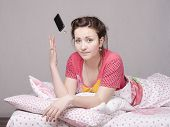 Young Girl In The Bed And Threw Phone